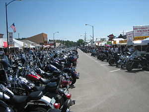 Sturgis, South Dakota - Motorbikes lined up on Main Street during Bike Week