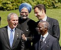 Manmohan Singh, with the U.S. President, Mr. George W. Bush, the French President Nicolas Sarkozy and South African President Thabo Mbeki during a photo session at the G-8 Summit in Heiligendamm, Germany on June 08, 2007.jpg