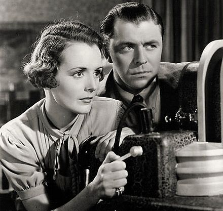 Mary Astor and Lyle Talbot in Trapped by Television.
