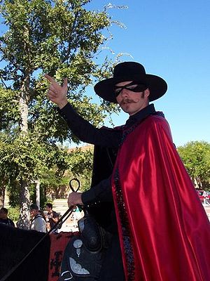 The Masked Rider - The Masked Rider gives the Guns Up hand sign.