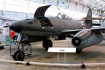 Me 262 A-1a on display at RAF Cosford. Some A-1a aircraft (including this example), like the A-2a bomber variant, attached additional hardpoints for extra weapons near the ejector chutes of the cannons, such as a bomb rack under each side of the nose. Me262 02.jpg