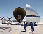 Members of the flight and ground crews prepare to unload equipment from NASA's B377SGT Super Guppy T DVIDS727520.jpg