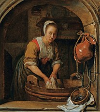 Woman washing textiles in a tub