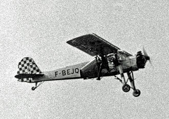 Léo Valentin - Leo Valentin taking off strapped to the outside of a Morane-Saulnier MS.502 Criquet in May 1955. He faces backward and his wooden wings are fitted to the side of the aircraft.