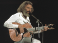 Moustaki-guitare-1974.png