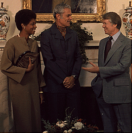Manley (age 52) and his fourth wife Beverly with US president Jimmy Carter in 1977 Mrs. Michael Manley, Prime Minister Michael Manley and Jimmy Carter during an Oval Office meeting 1977.png