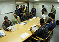 Multinational participants in a Combined Task Force 521 convoy exercise review their route, communications guidelines and operational plan during a conference aboard a large natural gas tanker during 130520-N-PV215-031.jpg