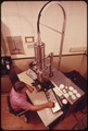 NATIONAL WATER QUALITY LABORATORY, OPERATING THE ELECTRON MICROSCOPE - NARA - 551594.tif