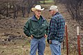 NRCS District Conservationist Tony Dean (left) discusses ranch management options with a Jack County landowner after a wildfire burned through the area three weeks earlier. (24816093950).jpg