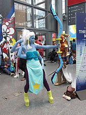 Cosplay of a blue character with four arms and a bow