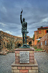 Statue of Miguel de Cervantes at the harbour of Naupactus (Lepanto) (Source: Wikimedia)