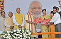 Narendra Modi presents the house keys to beneficiaries at the inauguration of the New Housing Scheme, in Chandigarh. The Governor of Punjab and Haryana and Administrator, Union Territory, Chandigarh.jpg