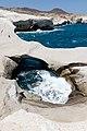 Natural swimming pool among volcanic rocks on Milos Island, Greece.jpg