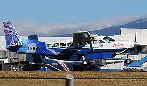 Nature Air Cessna Caravan 208 TI-BBC (13433657575).jpg