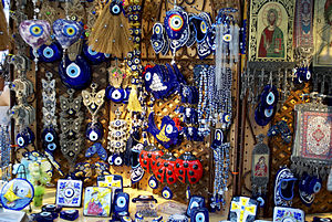 Nazar (amulet) - Nazars (charms against the evil eye) sold in a shop in Quincy Market, Boston, Massachusetts, USA. Note the various modifications to the simple traditional form, such as setting the nazar into butterflies or Christian imagery.