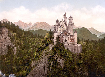 Neuschwanstein Castle (pictured) and Hohenschwangau Castle draw many tourists to the region annually. Neuschwanstein Castle LOC print rotated.jpg