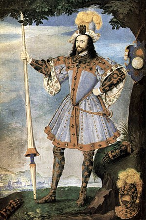 "Accession Day tilt - George Clifford, 3rd Earl of Cumberland attired as the Knight of Pendragon Castle for the Tilt of 1590, by Nicholas Hilliard. His pageant shield leans against the tree. The Queen's ""favour"", a glove, is attached to his hat."