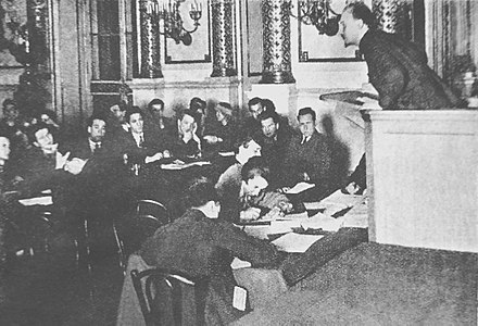 Bukharin delivers the welcome speech on the meeting of Young Communist International, 1925 Nikolai Bukharin delivers the welcome speech on the meeting of Young Communist International 1925.jpg