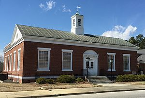 Louis A. Simon - This old post office at the northwest corner of James and N. Main Streets in Mullins, South Carolina, was built in 1938 and is used by the neighboring Baptist church (as of 2015).