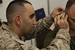 On pins and needles, Navy doctor branches out with deployment medicine 131213-M-ZB219-009.jpg