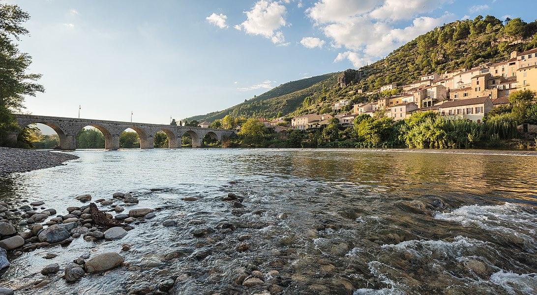 The Orb River and the village of Roquebrun, Hérault, France. Haut-Languedoc Regional Natural Park.