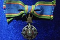 Order of the Crown of Thailand - 5th Class (Member) - female.jpg