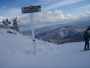 Killington Ski Resort - A sign pointing to Devil's Fiddle and Outer Limits, some of the steepest trails at Killington