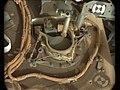 PIA22327-MarsCuriosityRover-DrillBitOverSampleInlet-Sol2068-20180531.jpg
