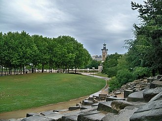 "Parc Georges-Brassens - The park has lawns, groves of trees, and a ""wall"" of artificial rocks for children to climb"
