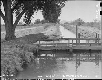 "Poston War Relocation Center - Image: Parker, Arizona. ""The land is plentiful. But the water is scarce"". Irrigation canals such as that . . . NARA 536249"