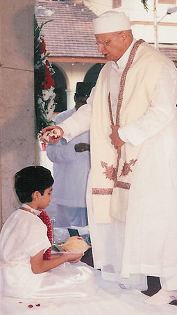 Parsi Navjote ceremony (rites of admission into the Zoroastrian faith) Parsi-navjote-sitting.jpg