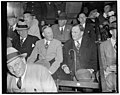 Party Leaders enjoy opening game. Washington, D.C., April 19. Party ties were forgotten today as Democratic and Republican members of Congress attended the opening game of the 1937 baseball LCCN2016871574.jpg
