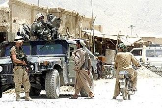 Kandahar massacre - U.S. soldiers patrolling the Panjwayi district near Kandahar in 2004.