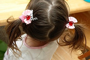 small girl with pigtails