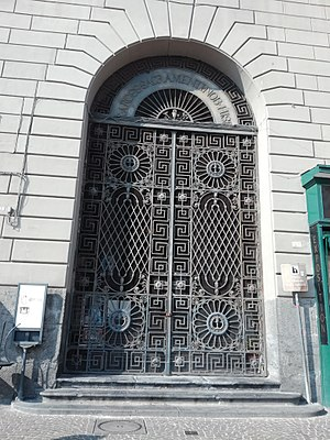 San Giacomo degli Spagnoli, Naples - Façade of St. James palace with the entrance arch to the church in the foreground.