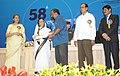 Pratibha Devisingh Patil presenting the Swarna Kamal Award to Shri N. Manu Chakravarthy for the Best Film Critic (Joshy Joseph), at the 58th National Film Awards function.jpg