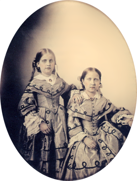 Pedro II's surviving children in 1855: Princesses Leopoldina and Isabel (seated) Princess Isabel and Leopoldina 1855 frame removed.png