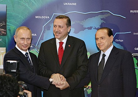 Erdogan, Vladimir Putin and Silvio Berlusconi at the opening of the Blue Stream gas pipeline in Turkey in November 2005 Putin Erdogan Berlusconi.JPG