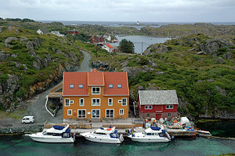 Røværsholmen Lighthouse - View of Røvær island with the lighthouse in the distance.