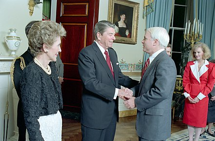 President Ronald Reagan greets McCain as First Lady Nancy Reagan looks on, March 1987 Reagans with John McCain 1987.jpg