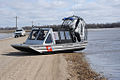 Red River flood 2010 and a USCG airboat.jpg