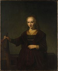 Rembrandt - Portrait of a woman holding a fan and the back of a chair.jpg