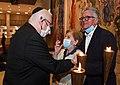Reuven Rivlin awards a certificate of appreciation to Holocaust survivor Itzik Yaakobi as part of the «Flower to Survival» project, April 2021 (GPOMN1 8769 1).jpg