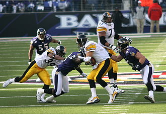 Jarret Johnson - Johnson (95) and Bart Scott sacking Ben Roethlisberger of the Pittsburgh Steelers in 2006. Terrell Suggs looks on.