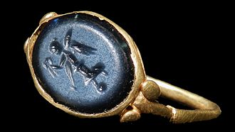 Cobalt glass - Late Roman (circa 4th century AD) finger ring with blue glass intaglio of the figure of Victory