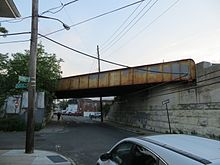 Rusting trestle over a one-way street
