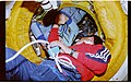 STS071-101-010 - STS-071 - STS-71 Gibson and Mir 18 Dezhurov in docking tunnel - DPLA - a3b1a5d6476b0d599cd24184b1920278.jpg