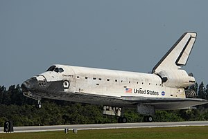 With main gear down on Runway 33, space shuttl...