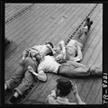 Sailors sleeping on flight deck of the USS Lexington (CV-16). - NARA - 520899.tif