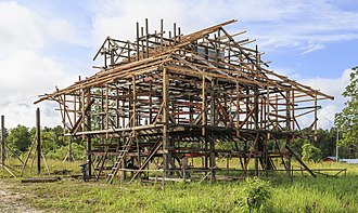 Framing (construction) - The erection of a wooden frame in Sabah, Malaysia.